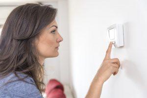 Woman checks the heater blower setting
