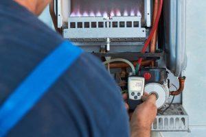 HVAC Technician Repairs Furnace and Heater